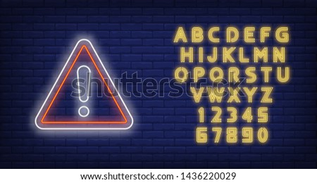 Warning neon sign. Exclamation mark in triangle on brick wall background. Vector illustration in neon style for billboards, signboards, signage