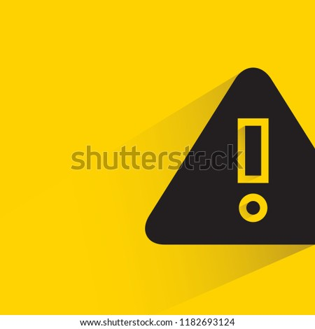 warning sign with drop shadow in yellow background