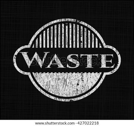Waste chalkboard emblem on black board
