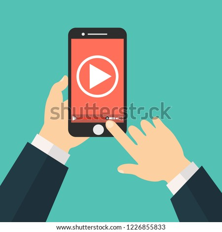 Watch videos on your phone. Mobile phone with video player on the screen. Play online video on your phone.Mobile video streaming technologies.