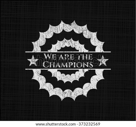 We are the Champions written on a blackboard