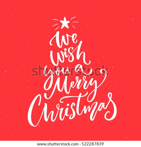 Shutterstock We wish you a Merry Christmas text. Calligraphy text for greeting cards on red background.