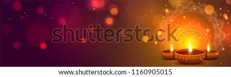 Website header or banner design with illustration of realistic illuminated oil lamps and floral mandala on blurred bokeh background for Diwali festival and space for your text.