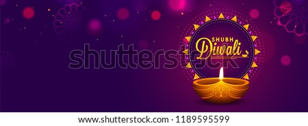 Stock Photo Website header or banner design with realistic oil lamp on purple background for Diwali Festival celebration.