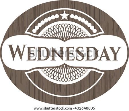 Wednesday badge with wood background