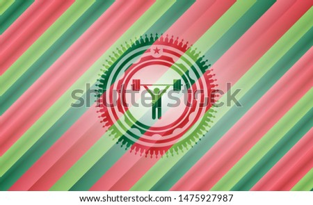 weightlifting icon inside christmas colors emblem.