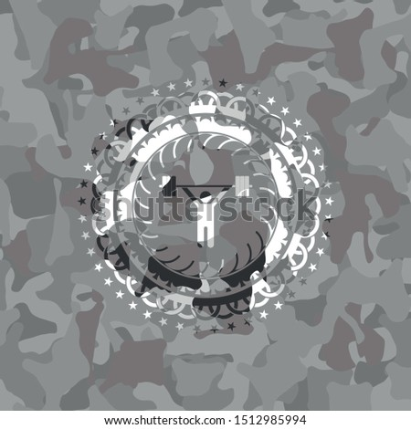 weightlifting icon inside grey camouflage texture
