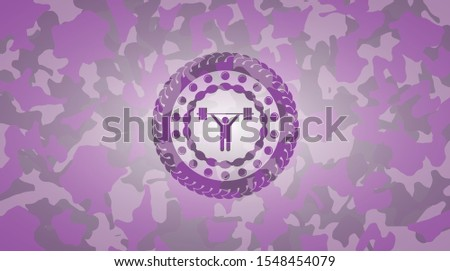 weightlifting icon inside pink and purple camouflage texture