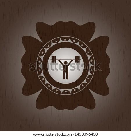 weightlifting icon inside retro style wood emblem