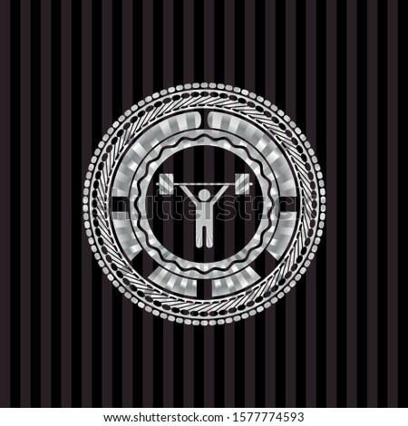weightlifting icon inside silvery emblem or badge