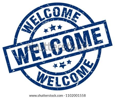welcome blue round grunge stamp