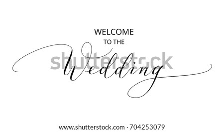 Welcome to the wedding text, hand written custom calligraphy isolated on white. Elegant ornate lettering with swirls and swashes. Great for wedding invitations, party decoration, photo overlays. #704253079