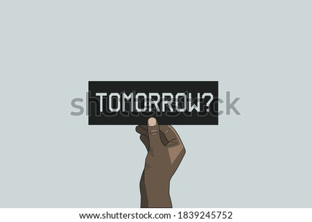 What will be tomorrow, what will happen tomorrow concept. Hand holding a black card with a text saying tomorrow? Motivation for a change. The change could be positive or negative Сток-фото ©