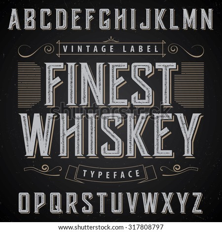 Whiskey label font and sample label design with decoration and ribbon. Vintage font, good to use in any vintage style labels of alcohol drinks - absinthe, whiskey, gin, rum, scotch, bourbon etc.