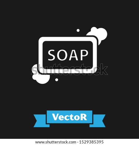 White Bar of soap with foam icon isolated on black background. Soap bar with bubbles.  Vector Illustration