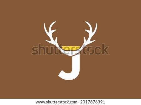 White brown color of J initial letter with deer horn design Foto stock ©