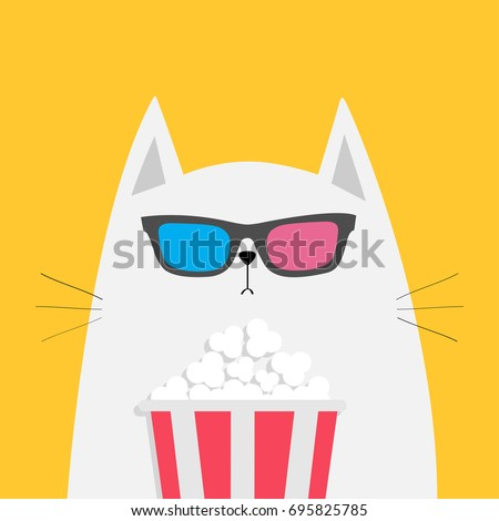 white cat eating popcorn