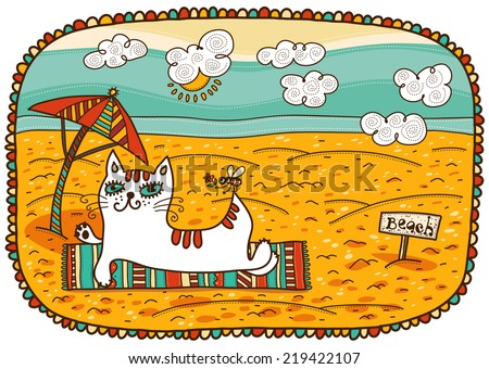 white cat lying on the beach