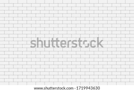white concrete wall the grid
