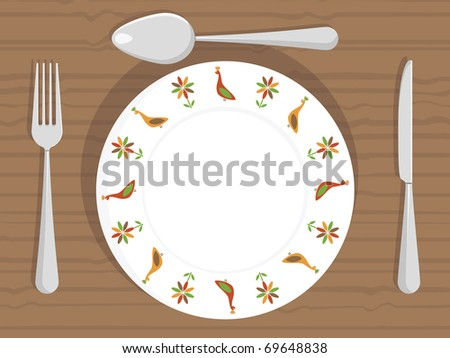 white dinner plate with peacock decorations and cutlery