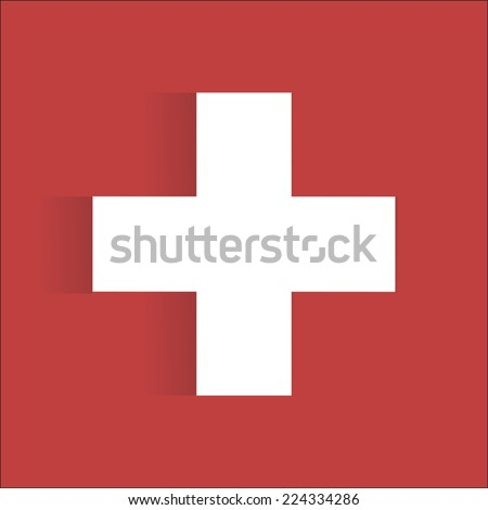 White first aid sign with shadow on red background