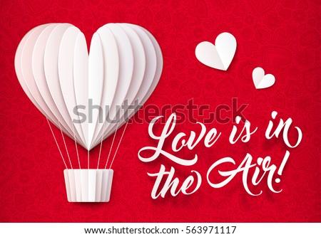 white folded paper heart shape