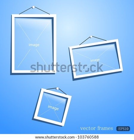 white frames on the blue wall