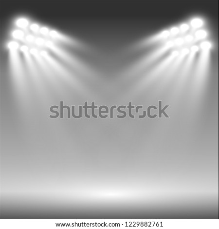 White glowing light.Stadium floodlights brightly illuminate evening or night sports games, concerts, shows, events. Isolated on a transparent background. Arenas of bright spotlights. Bright lights.