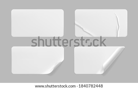White glued crumpled stickers with curled corners mock up set. Blank white adhesive paper or plastic sticker label with wrinkled and creased effect. Template label tags close up. 3d realistic vector Photo stock ©
