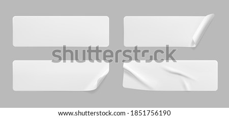White glued crumpled stickers with curled corners mock up set. Blank white adhesive paper or plastic sticker label with wrinkled and creased effect. Template label tags close up. 3d realistic vector