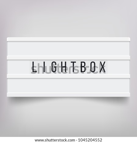 White lightbox with customizable design. Classic banner for your projects or advertising. Light banner, vintage billboard or bright signboard. Cinema or theater light box frame for ads. Blinking light