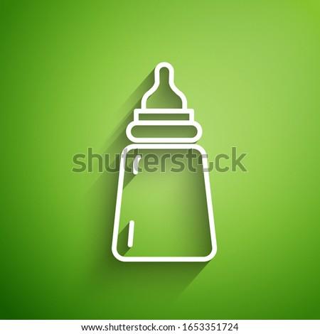 White line Baby bottle icon isolated on green background. Feeding bottle icon. Milk bottle sign.  Vector Illustration