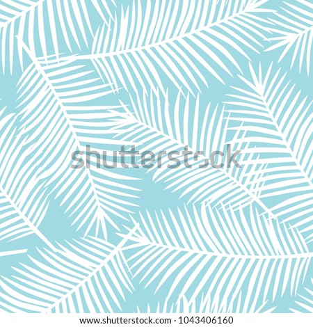 white palm leaves on a blue