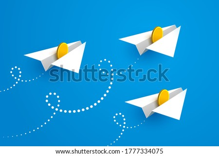 White paper airplanes with gold coins inside are flying forward over blue sky background. Concept of money transfers, transactions, online payments, successful business and startup Stok fotoğraf ©