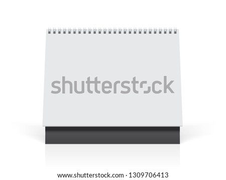 white paper calendar stands on the table