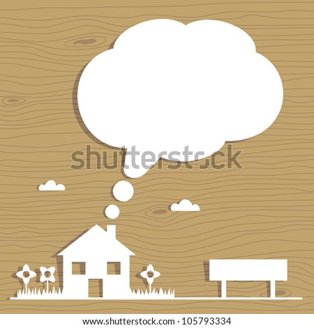 white paper house on wood grain background with speech bubble for text