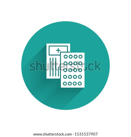 White Pills in blister pack icon isolated with long shadow. Medical drug package for tablet, vitamin, antibiotic, aspirin. Green circle button. Vector Illustration
