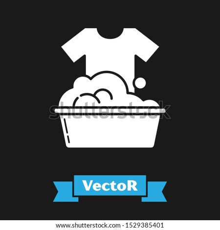 White Plastic basin with soap suds icon isolated on black background. Bowl with water. Washing clothes, cleaning equipment.  Vector Illustration