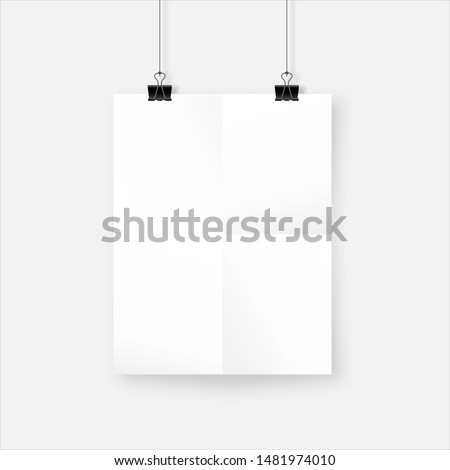 White realistic crumpled paper sheet with shadow. Wrinkled poster hanging on bulldog clips. Mockup template for your design.