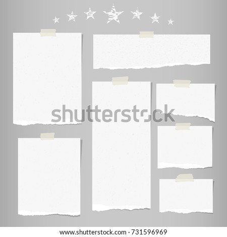 White ripped note, notebook paper for message or text stuck with sticky tape on gray background with stars.