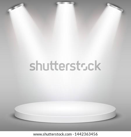 White round winner podium on gray background. Stage with studio lights for awards ceremony. spotlights illuminate. Vector illustration.