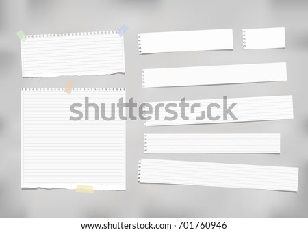 White ruled, striped note, copybook, notebook paper stuck with adhesive tape on grey background.