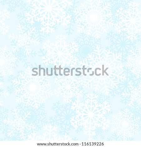 White snowflakes on blue background. Seamless pattern