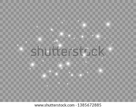 White sparks shine a special light effect. Vector glitters on a transparent background. Christmas abstract pattern. Glittering particles of magical dust