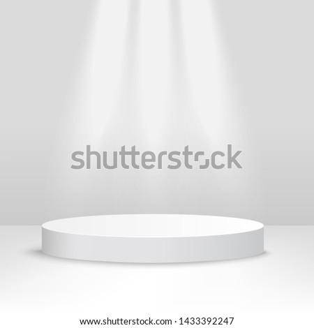 white stage platform lit from