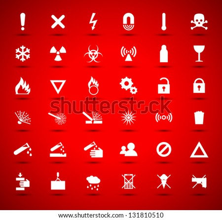 White warning and danger signs collection on red background