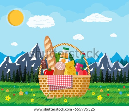 wicker picnic basket full of