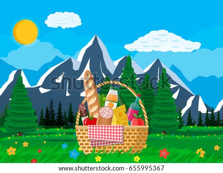 wicker picnic basket full of
