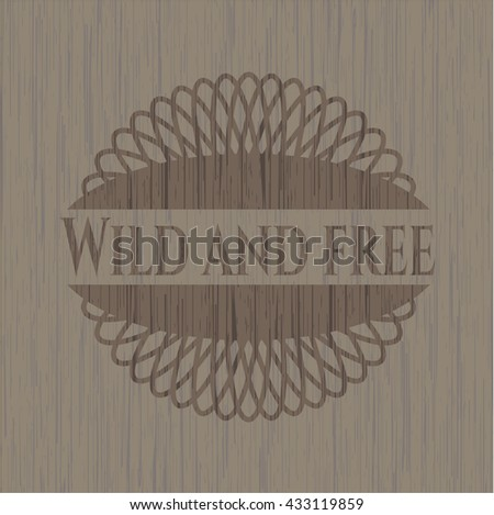 Wild and free badge with wood background