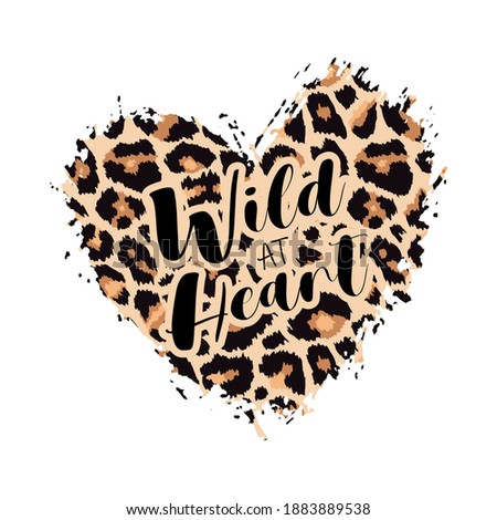 Wild at Heart Leopard Heart Shape Print. Slogan with wild animal skin pattern texture, hand drawn brush stroke. Vector design element for fashion print design, tag, card, backgrounds, Valentines day.